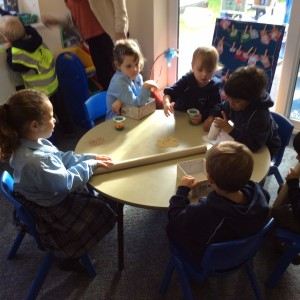 The children began selecting materials to create their instruments. Can you guess what they planned to make?